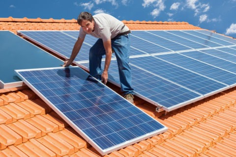 contractor installing solar system in roof