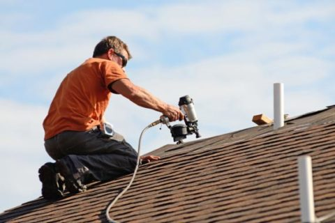 Roof installer working on home in Los Angeles.