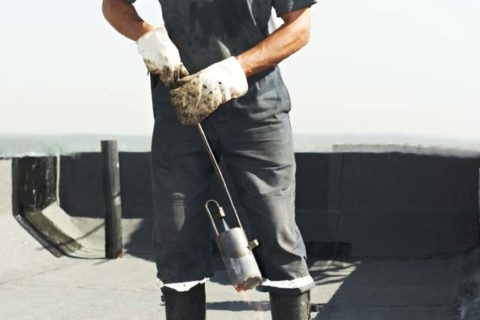 Roofing company providing roof repair service for home.